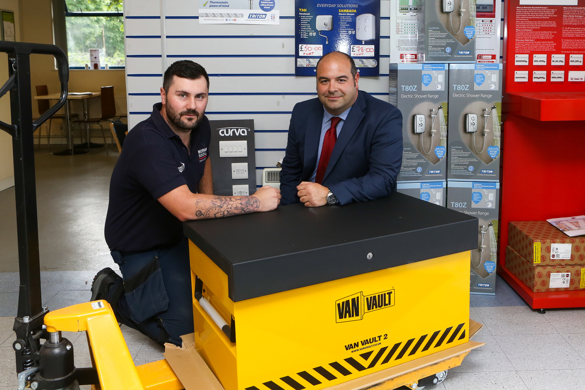 'Tank up with Triton' winner, Glenn Price (left), and Rob Lemon (right), National Account Manager at Triton Showers