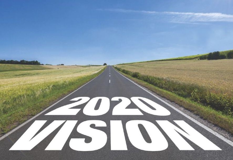 2020, Road sign in the grass field to new year and blue ...  2020 The Road Ahead